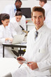 Portrait Of Technician In Laboratory With Colleagues