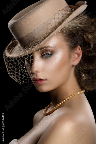 Charm. Retro Romantic Woman in Vintage Hat and Veil. Nostalgia