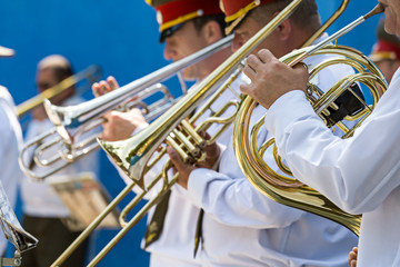 Brass band musicians with trumpets
