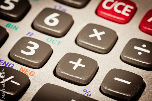 Macro detail of the plus sign on a calculator