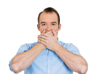 Man covering his mouth, speak no evil concept