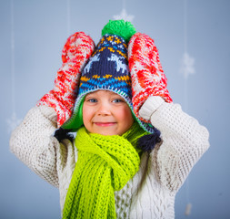 Funny boy in winter clothes