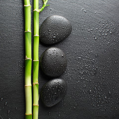 zen stones and bamboo with dew