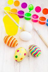 Easter eggs and process of painting eggs