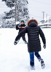 Teenager throwing snowballs