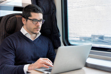 commuter working on a train