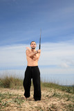 martial arts instructor with crowbar exercise outdoor