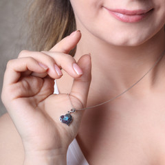girl with heart-shaped pendant