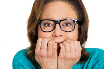 Old anxious nerdy woman biting her fingernails