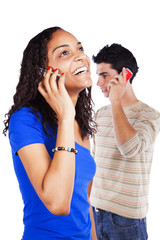 Multiracial couple holding cellphones
