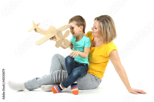 Beautiful mom with little daughter isolated on white