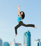 sporty woman jumping in sportswear