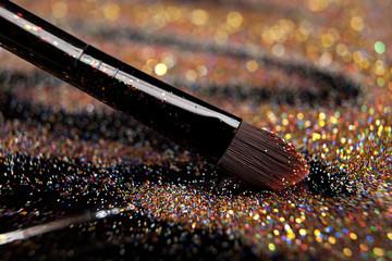 Closeup on makeup brush and shining powder