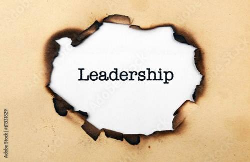 Leadership text on paper hole