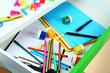 School supplies in open desk drawer close up