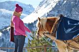 Girl and a horse. Braunwald, Switzerland