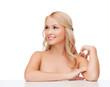 woman touching her shoulder skin