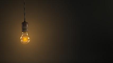 Vintage hanging light bulb over dark background