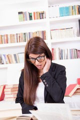 confused female student with books
