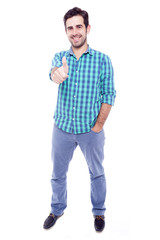 Handsome man thumbs up over a white background