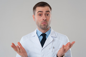 Doctor man shrug with raised hands. Expert opinion