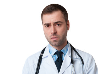 Male doctor with serious face and stethoscope around his neck