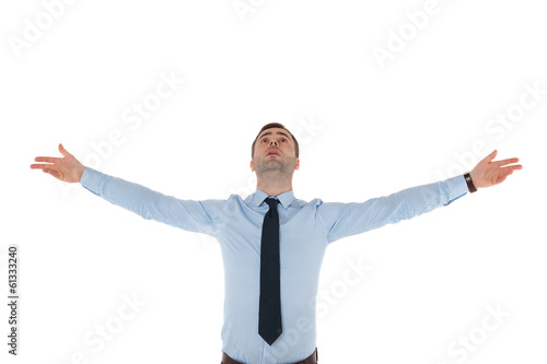 Business man with raised hands in air on white background