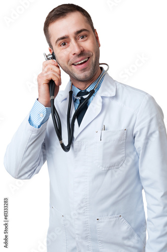 Funny smiling male Doctor holds stethoscope as mobile phone