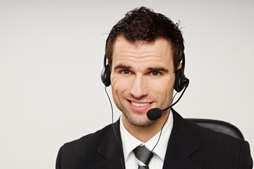 Handsome operator speaks into microphone