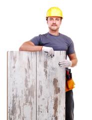 Carpenter holding the floor panel
