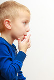 Portrait of cute boy child kid preschooler licking his fingers
