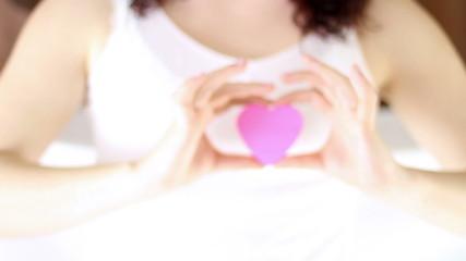 Hands Offering a Heart