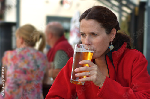 Woman drinks beer