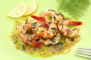 fried shrimps on a plate with garlic