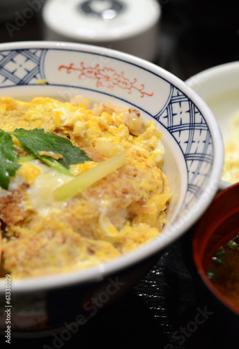 Close up of Katsudon pork cutlet with fried egg on rice