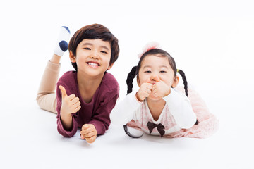 Happy Asian kids showing thumb