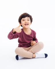 Young Asian boy showing thumb