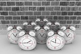 3d brick wall background with alarm clocks