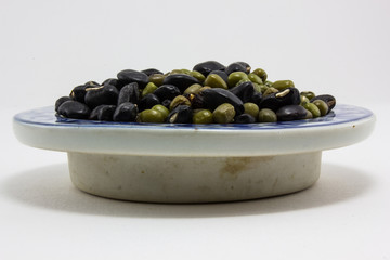 beans in bowl on isolated background