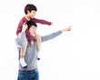 Young Asian father and little son indecated something