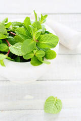 fresh mint in white mortar