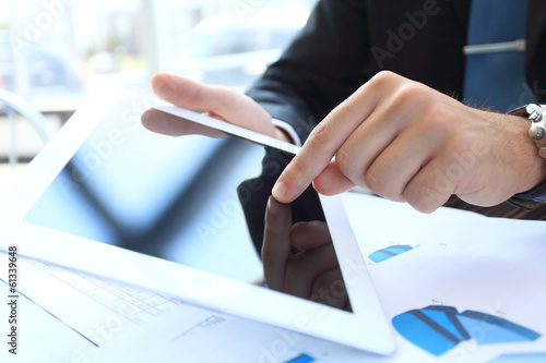 Hand touching on modern digital tablet pc at the workplace