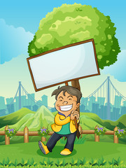 A smiling young man carrying an empty signboard