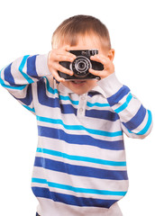 boy with a camera on a white background