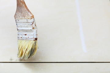 renovation at home brush primer grout of tiles resistant