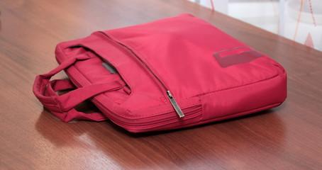 Laptop bag on wooden desk