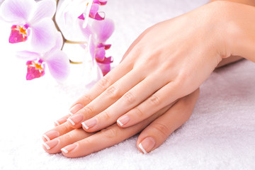 french manicure with pink orchid on the white
