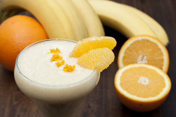 Cocktail of banana with orange and yogurt.