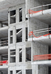 Modern building under construction, concrete walls and stairs