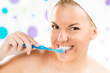 Portrait of Young woman brushing her teeth.